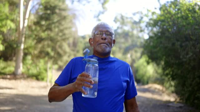 senior african american man drinking water - inhaling stock videos & royalty-free footage