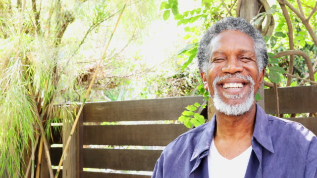 Senior African American Man Turning to the Camera and Smiling