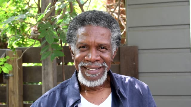 Senior African American man with beard smiling to camera