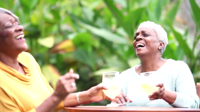 senior african american woman conversing, drinking - traditional lemonade stock videos & royalty-free footage