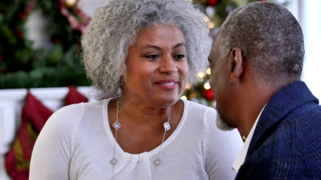 senior african american woman receives christmas gift from her husband - formal stock videos & royalty-free footage