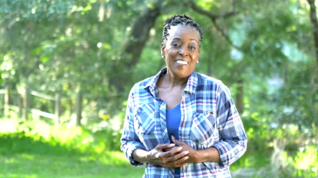 senior african american woman standing outdoors - plaid shirt stock videos & royalty-free footage