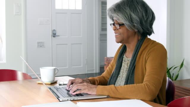 Senior African American woman using laptop