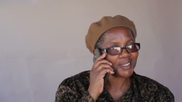 Senior african woman talking to a friend on her cellphone