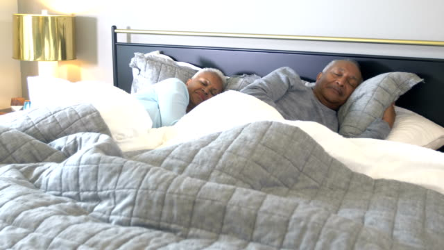 senior african-american couple asleep in bed - lying on side stock videos & royalty-free footage