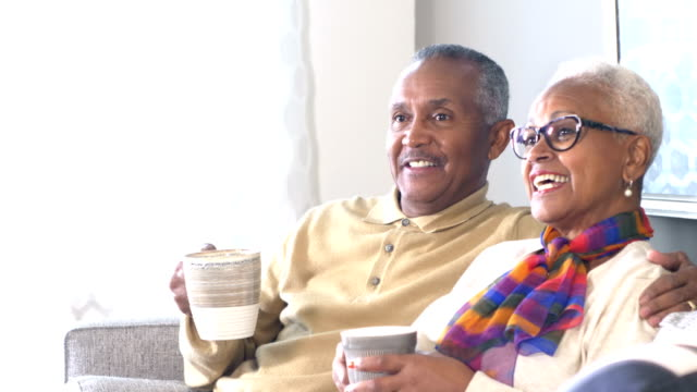 senior african-american couple at home, having coffee - close to stock videos & royalty-free footage
