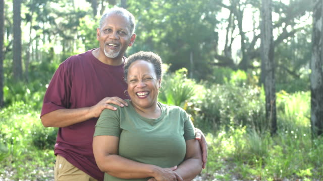 senior african-american couple at park - 60 69 years stock videos & royalty-free footage