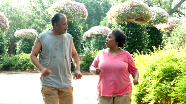 senior african-american couple exercising together - 60 69 years stock videos & royalty-free footage