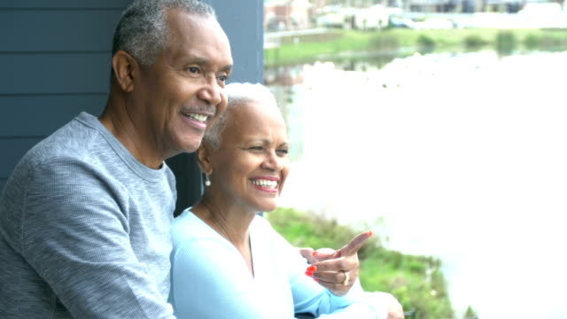 senior african-american couple on porch looking at view - veranda stock videos & royalty-free footage
