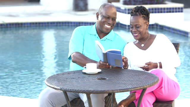 senior african-american couple relaxing by pool - senior couple stock videos & royalty-free footage