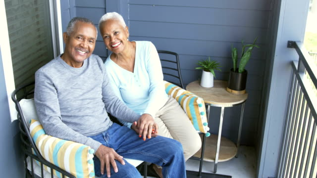 senior african-american couple relaxing on porch - porch stock videos & royalty-free footage