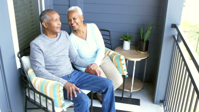 senior african-american couple relaxing on porch - veranda stock videos & royalty-free footage