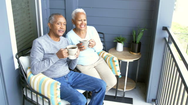senior african-american couple relaxing on porch - close to stock videos & royalty-free footage