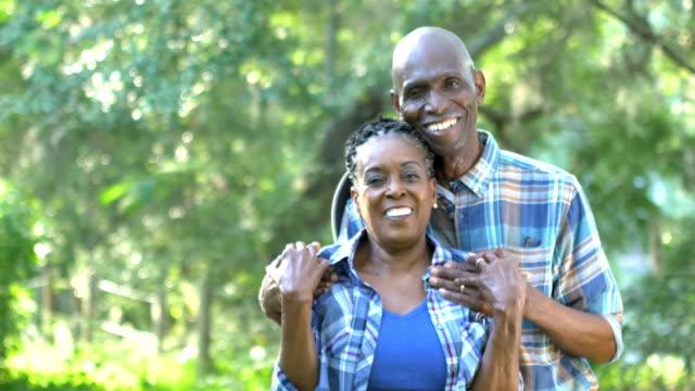 vídeos de stock e filmes b-roll de senior african-american couple standing outdoors - african american ethnicity
