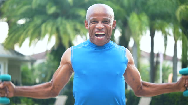 senior african-american man lifting hand weights - hand weight stock videos & royalty-free footage