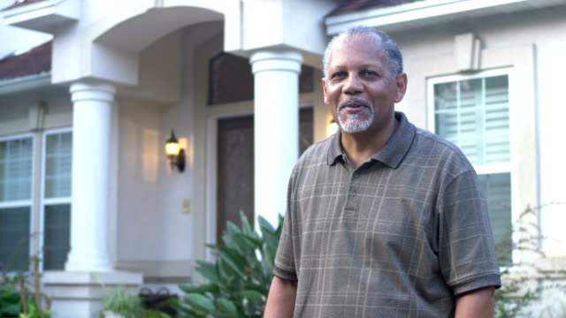 senior african-american man standing in front of house - front view stock videos & royalty-free footage