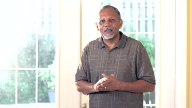 senior african-american man standing inside home - 60 69 years stock videos & royalty-free footage