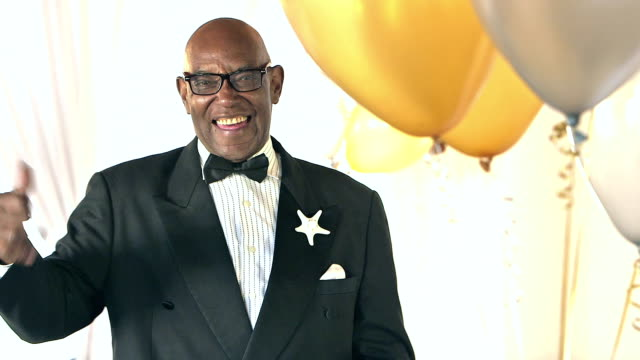 senior african-american man wearing black tuxedo - tuxedo stock videos and b-roll footage