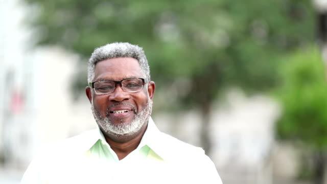 senior african-american man with beard, eyeglasses - males stock videos & royalty-free footage