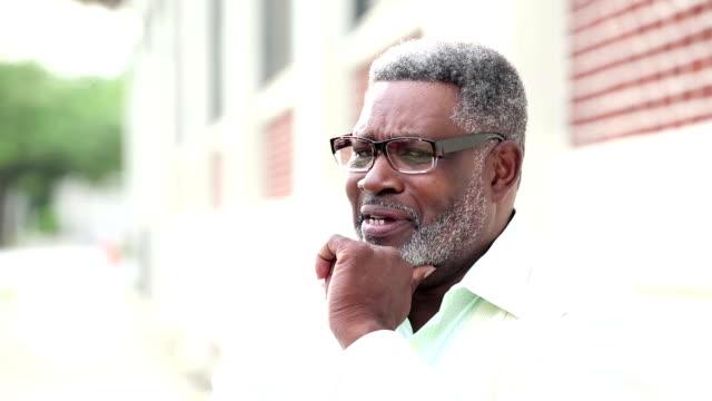 senior african-american man with beard, eyeglasses - hand on chin stock videos & royalty-free footage