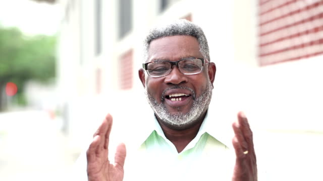 senior african-american man with eyeglasses, talking - hand on chin stock videos & royalty-free footage