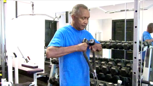 Senior African-American man working out at the gym
