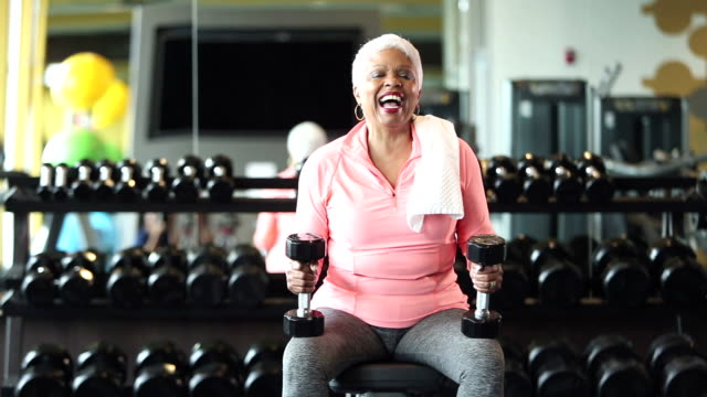 senior african-american woman at gym, holding dumbbells - hand weight stock videos & royalty-free footage