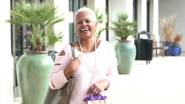 Senior African-American woman enjoying day in city