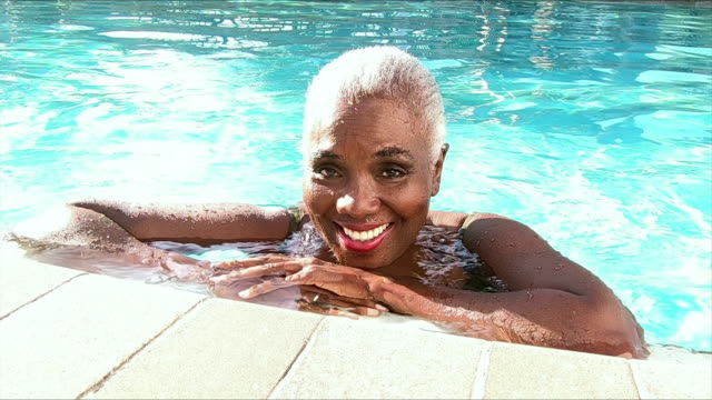 senior african-american woman in swimming pool - 60 69 years stock videos & royalty-free footage