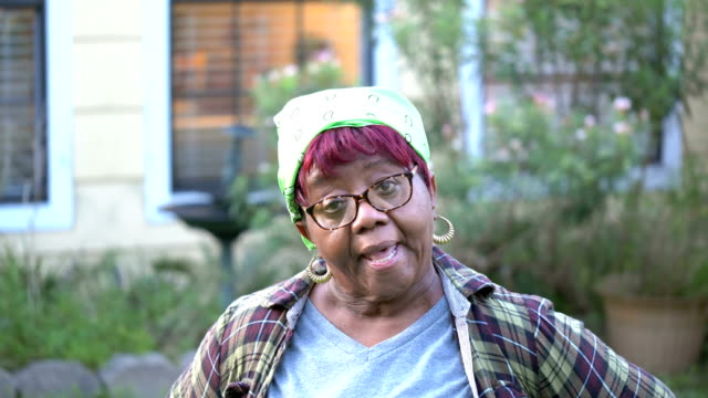 senior african-american woman outside her home - plaid shirt stock videos & royalty-free footage