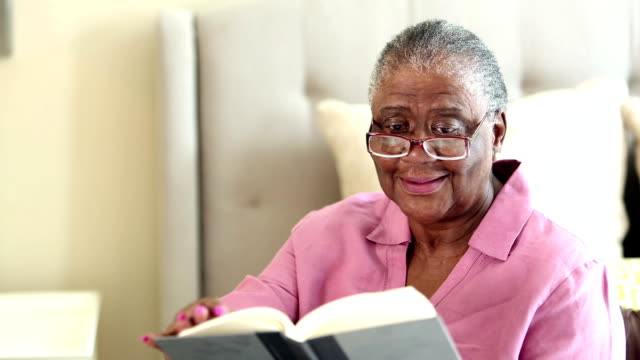 senior african-american woman reading book - reading glasses stock videos & royalty-free footage
