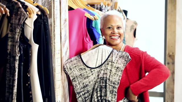 senior african-american woman shopping for clothing - boutique stock videos & royalty-free footage