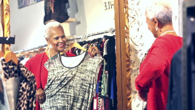 Senior African-American woman shopping for clothing