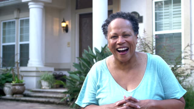 senior african-american woman standing in front of house - voluptuous stock videos & royalty-free footage