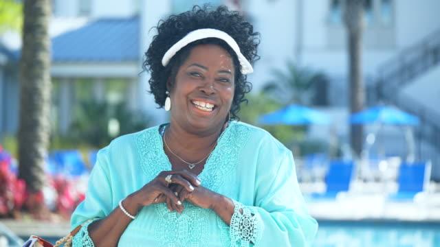 senior african-american woman standing on pool deck - sun visor stock videos & royalty-free footage