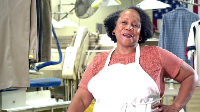 senior african-american woman working at dry cleaners - hand on hip stock videos & royalty-free footage