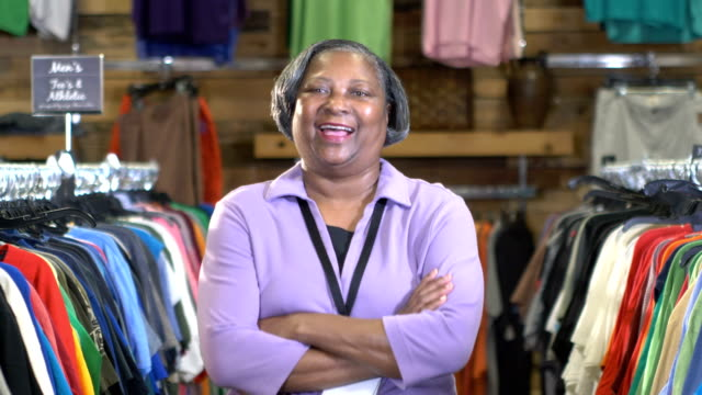 Senior African-American woman working in clothing store