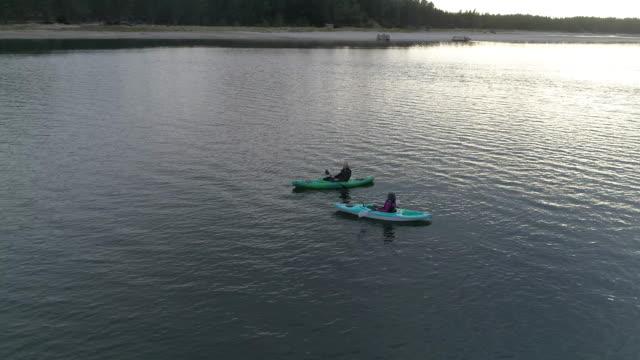 Senior age couple kayaking at dusk