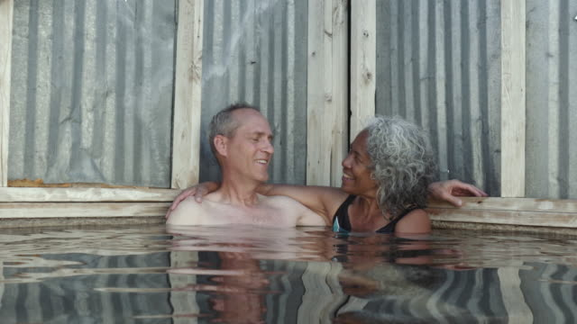 4K UHD: Senior Aged Couple Sitting in a  Hot Spring
