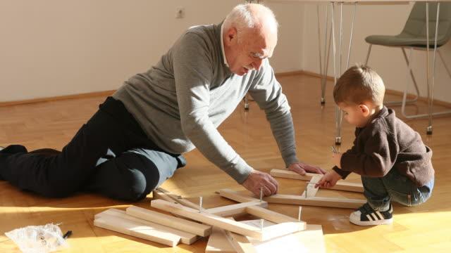senior and junior carpenter - craft stock videos and b-roll footage