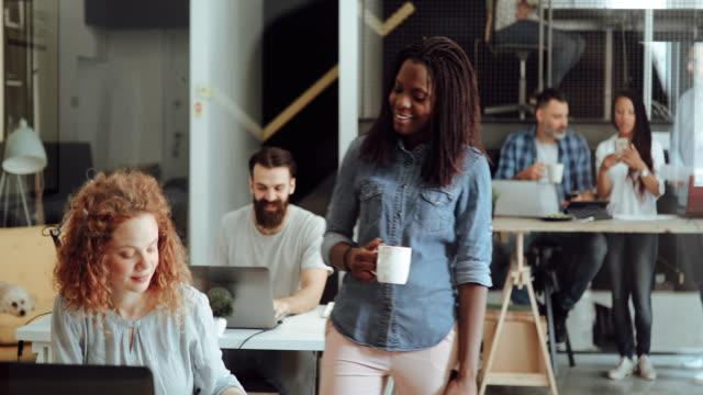senior art director mentoring new intern in modern office - ideas stock videos & royalty-free footage