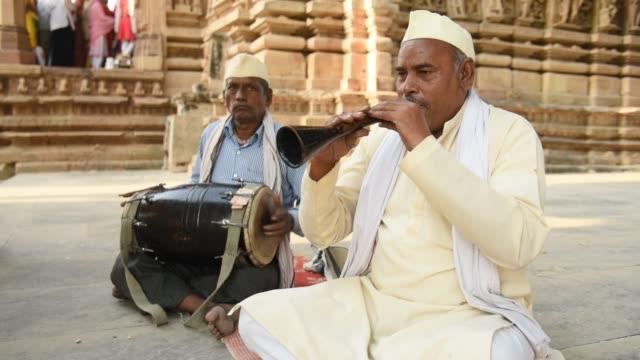 senior artist playing shehnai folk music of india - musical instrument stock videos & royalty-free footage