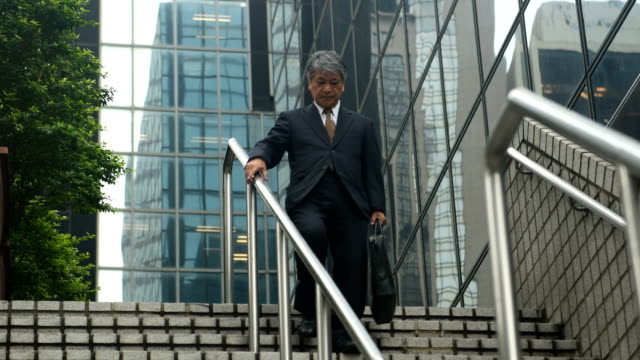 senior asian businessman on the move - steps and staircases stock videos & royalty-free footage