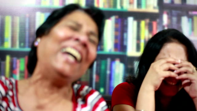 Senior Asian Indian and Young Woman Laughing like crazy
