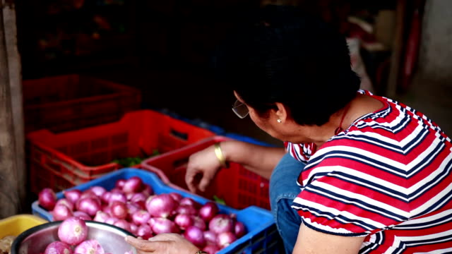 Senior Asian Indian Woman buying Vegetables from Greengrocer's Shop