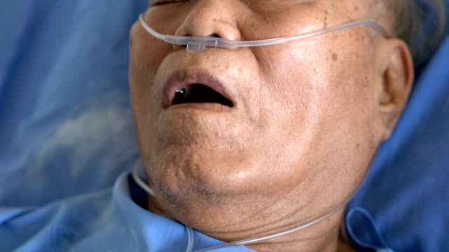 cu senior asian male patient mouth feeling hard to breathing - hospital bed stock videos & royalty-free footage
