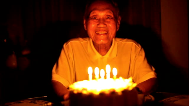 senior asian man blows out birthday candles - birthday stock videos and b-roll footage