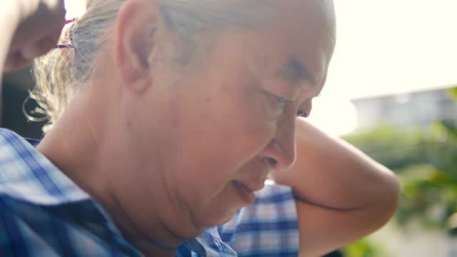 Senior Asian man doing a Pigtail long white hair.