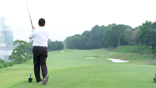 senior asian man hits a great tee shot - teeing off stock videos & royalty-free footage