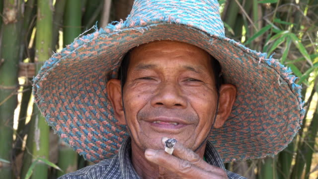 Senior Asian Men Smoking